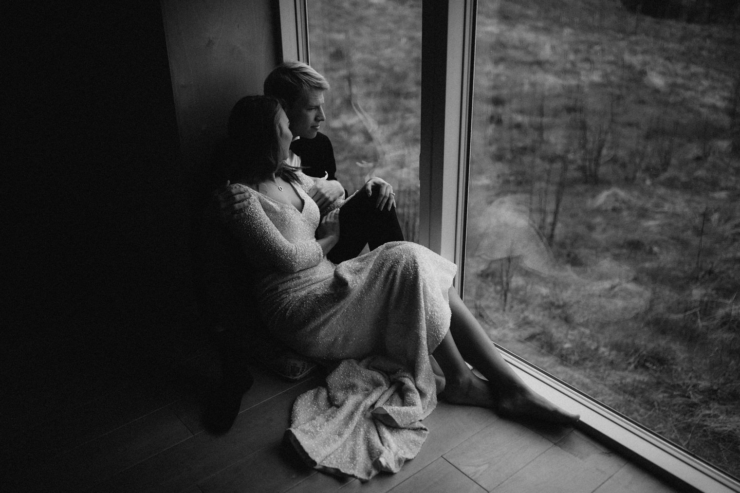 Bride and groom sharing a moment together looking at the landscape in Iceland