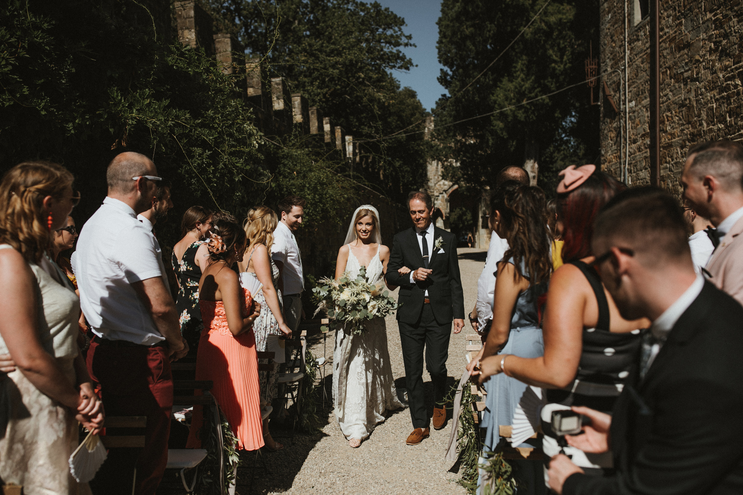 Bride and Father walking down aisle at Tuscan Castle Wedding ceremony