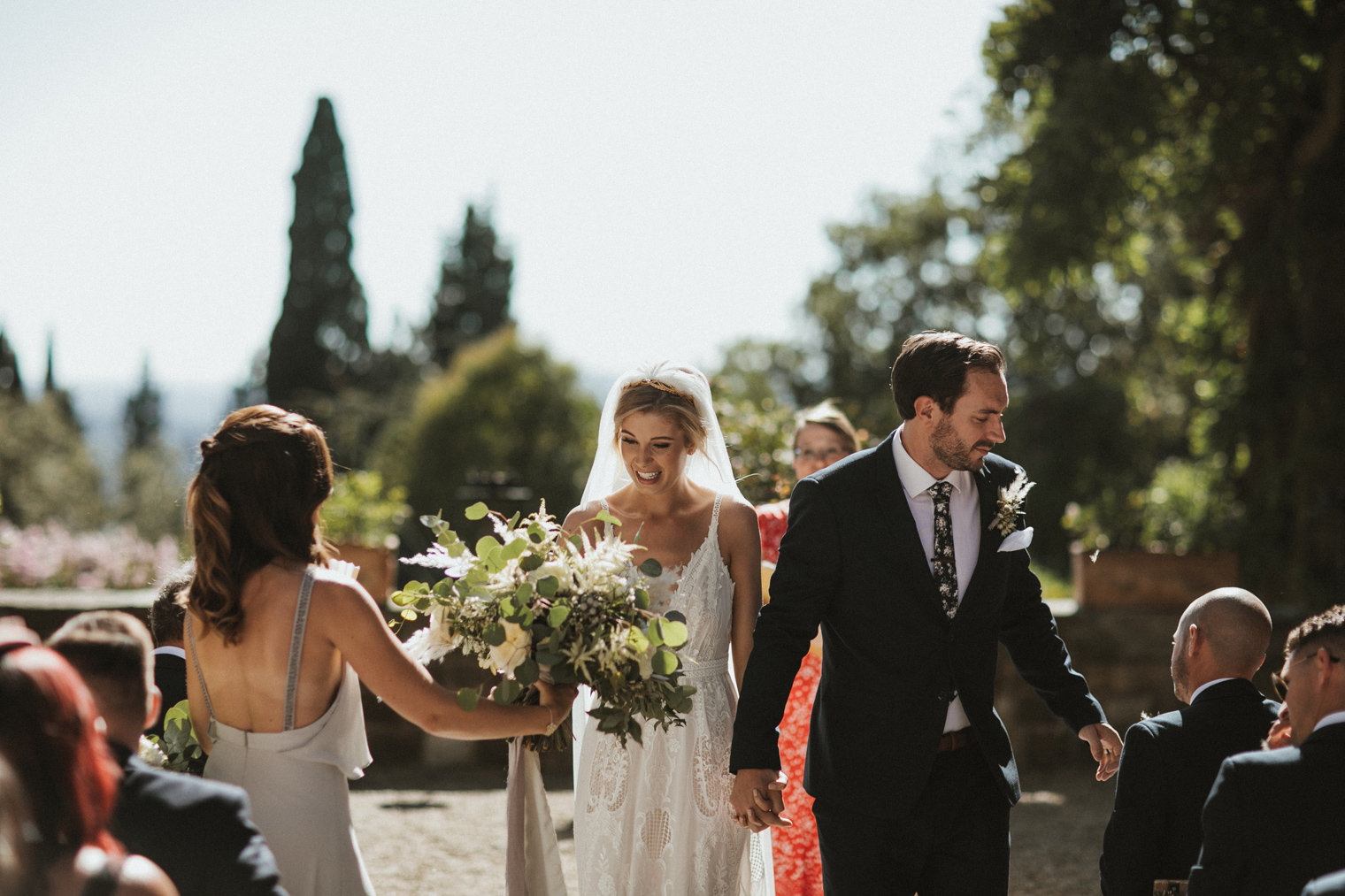 Bride and Groom walking down the aisle after ceremony at Castello Di Vincigliata