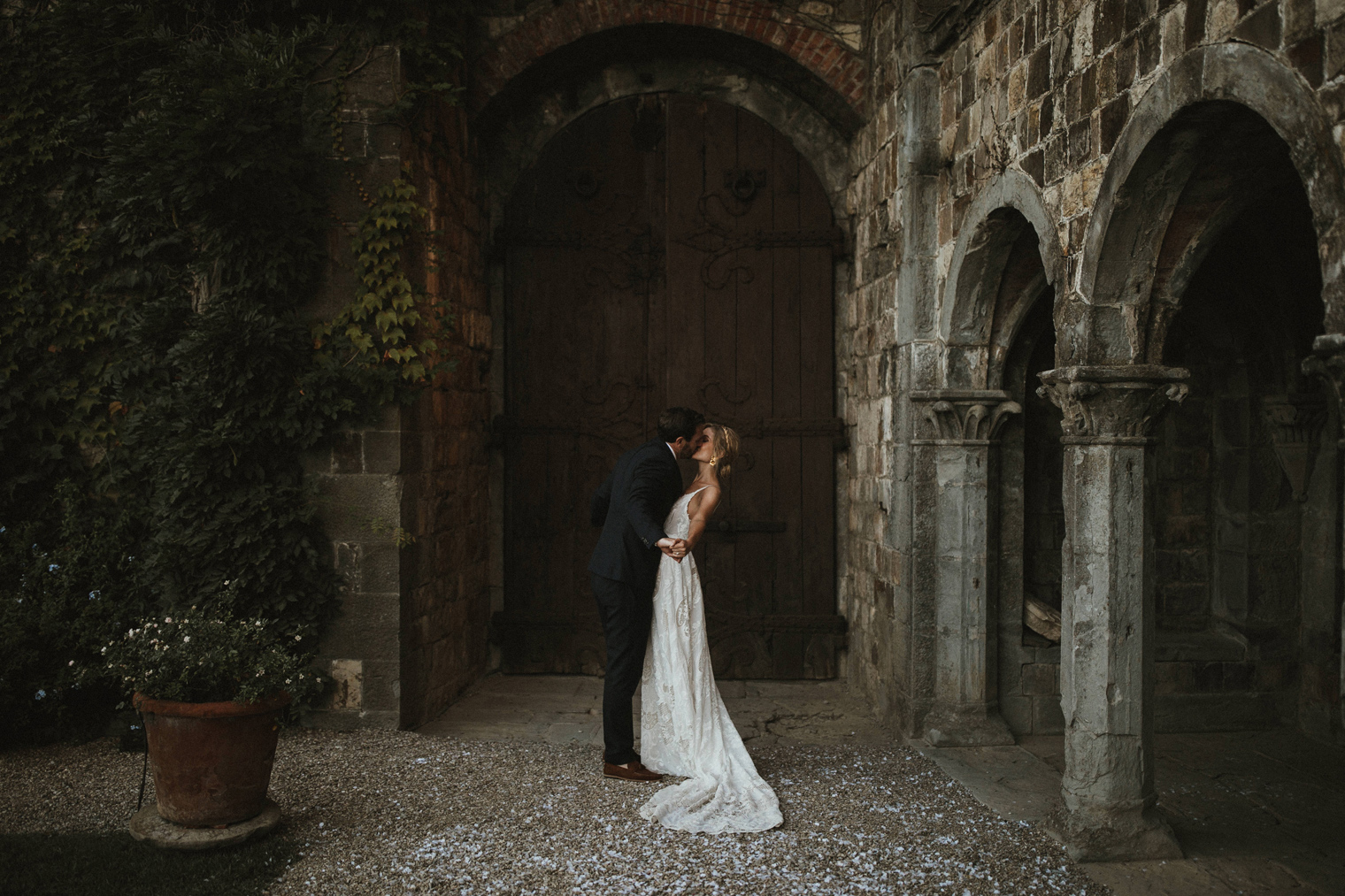 Bride and groom kissing after wedding ceremony in Italy