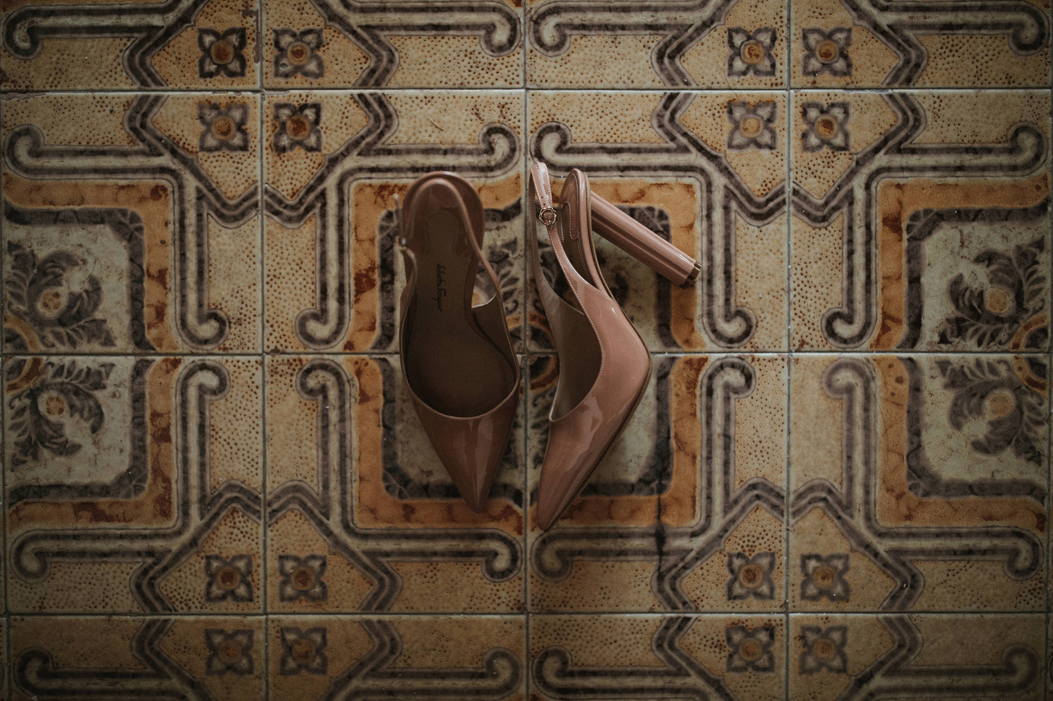 Salvatore Ferragamo shoes on interesting tiles in Italy