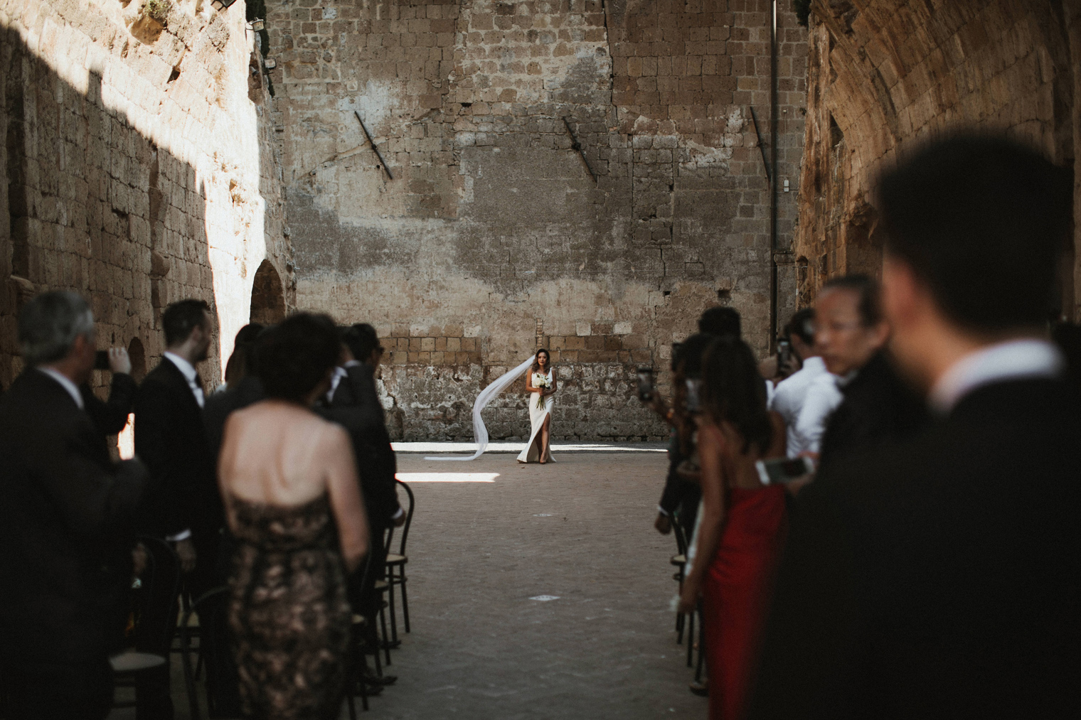 Dramatic entrance of bride at Cindy and Jason chose to have their stunning wedding at La Badia Di Orvieto.
