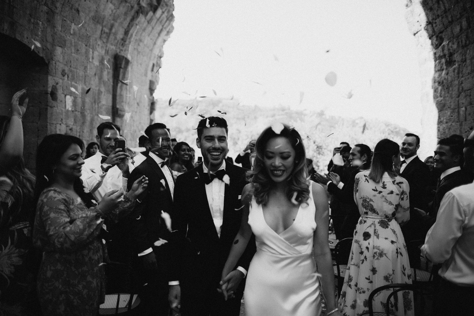 Confetti recession during Italian wedding at La Badia Di Orvieto