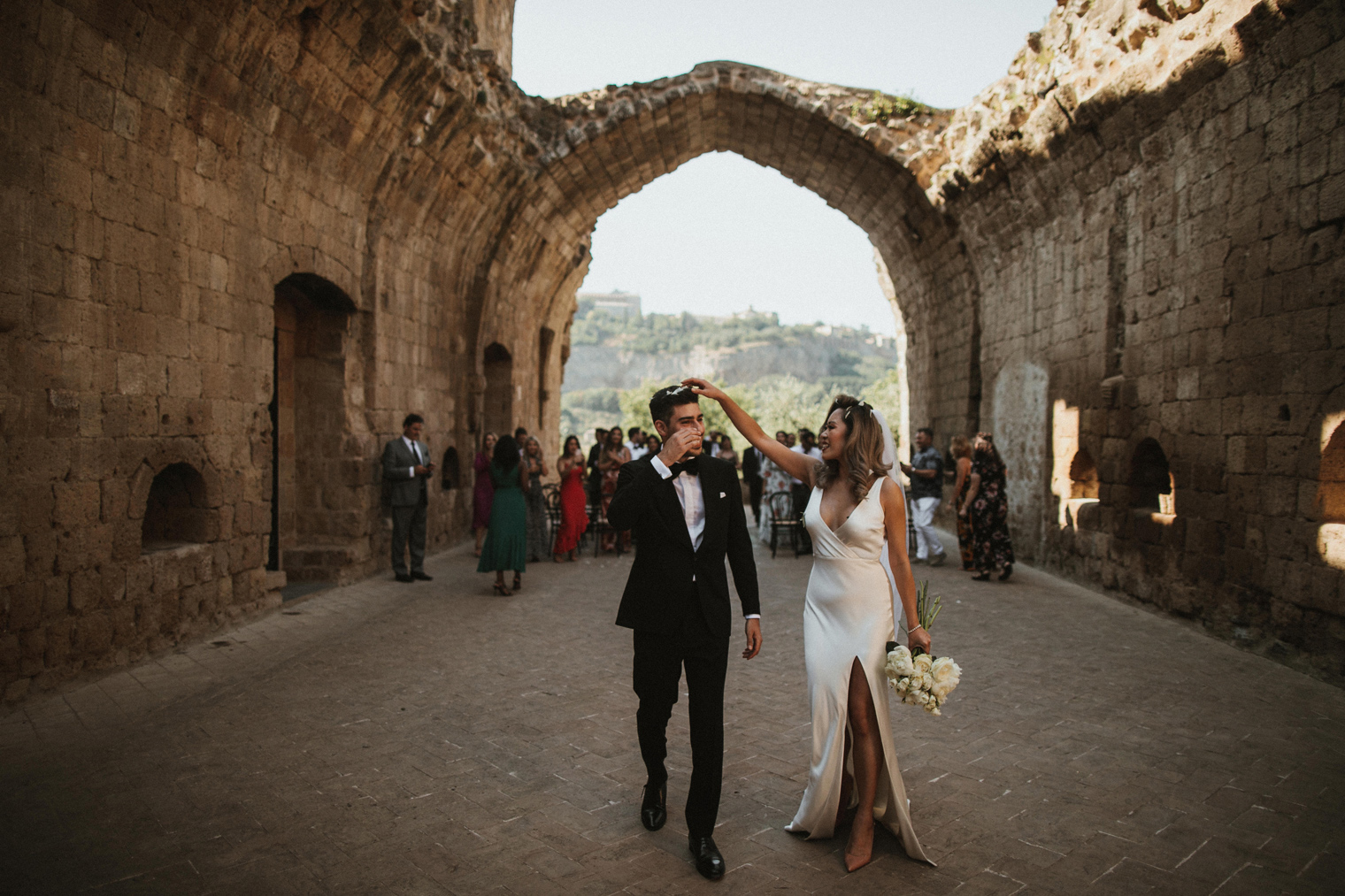 Bride and groom celebrating wedding at La Badia Di Orvieto