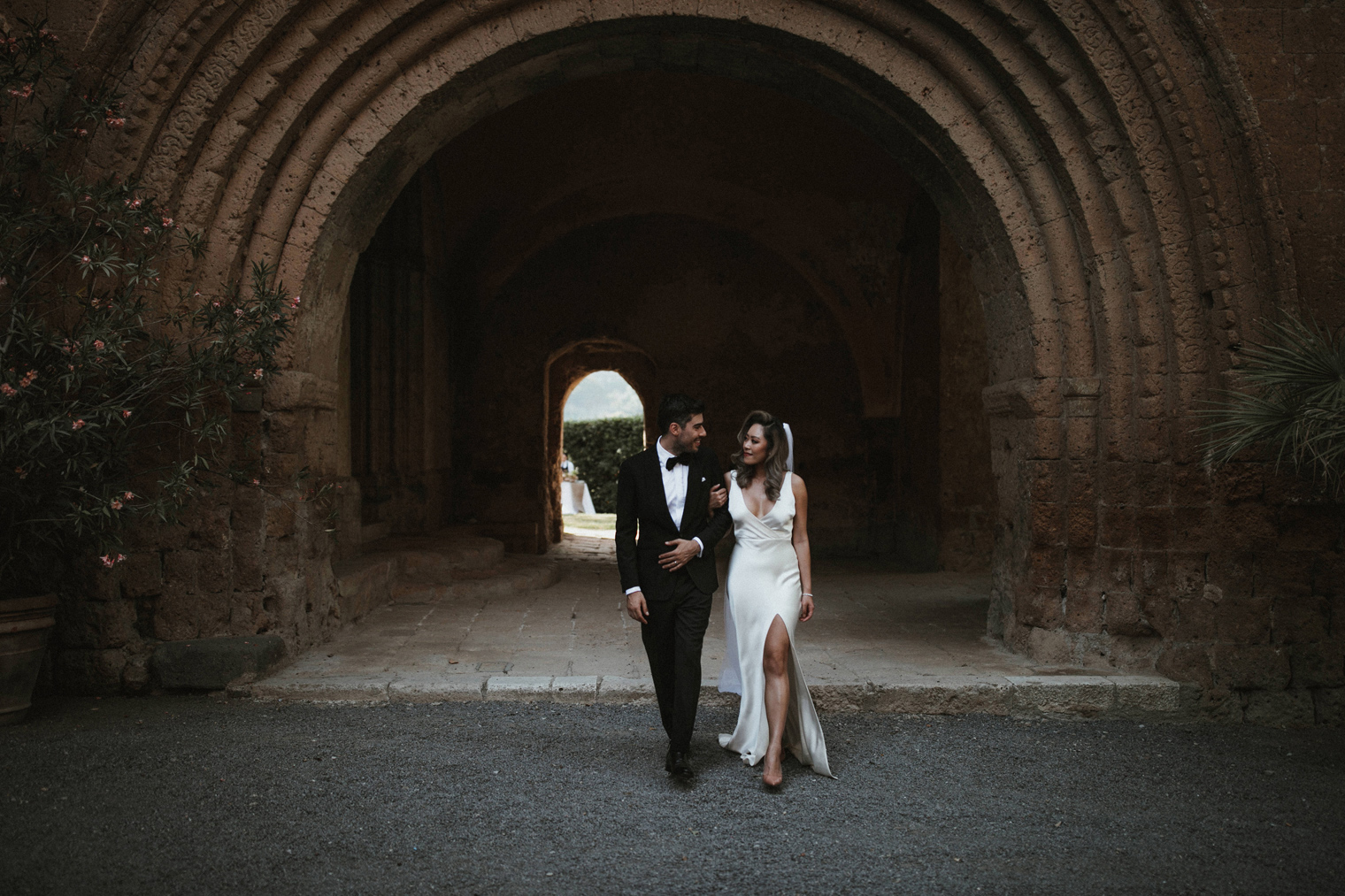 Bride and groom walking together in Umbria at La Badia Di Orvieto
