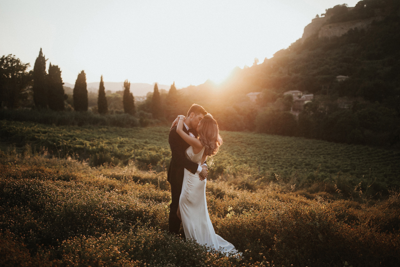 Couple kissing during sunset in Tuscany