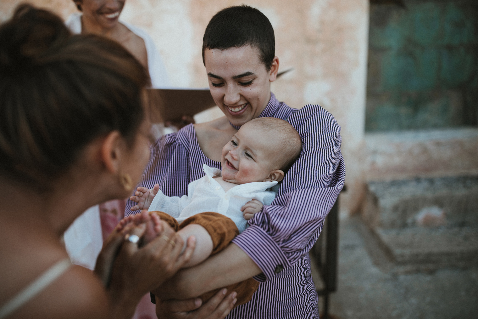 Baby smiling at bride during intimate wedding in Gallipoli