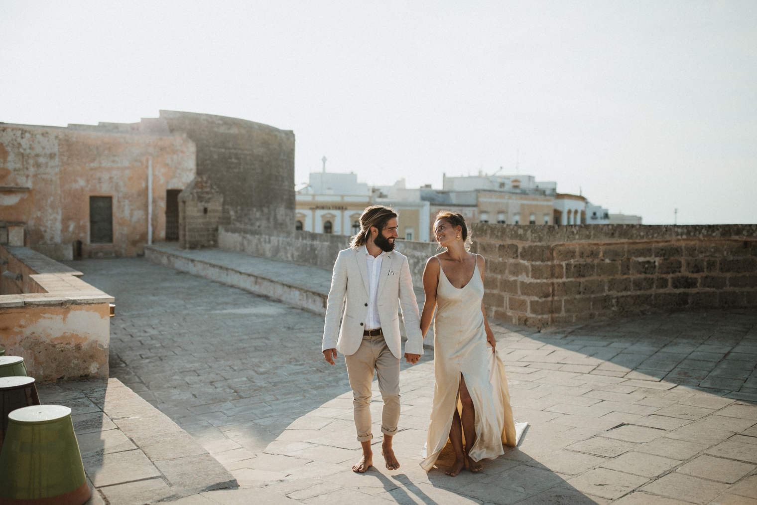 couple walking together at Castello di Gallipoli