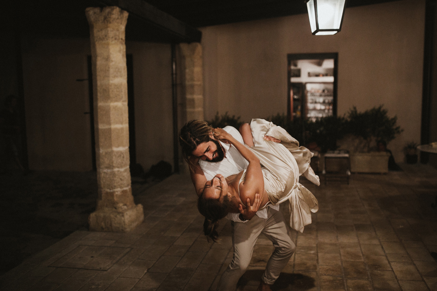 Groom dipping his bride during first dance at Castello Di Caprarica after intimate wedding in Gallipoli