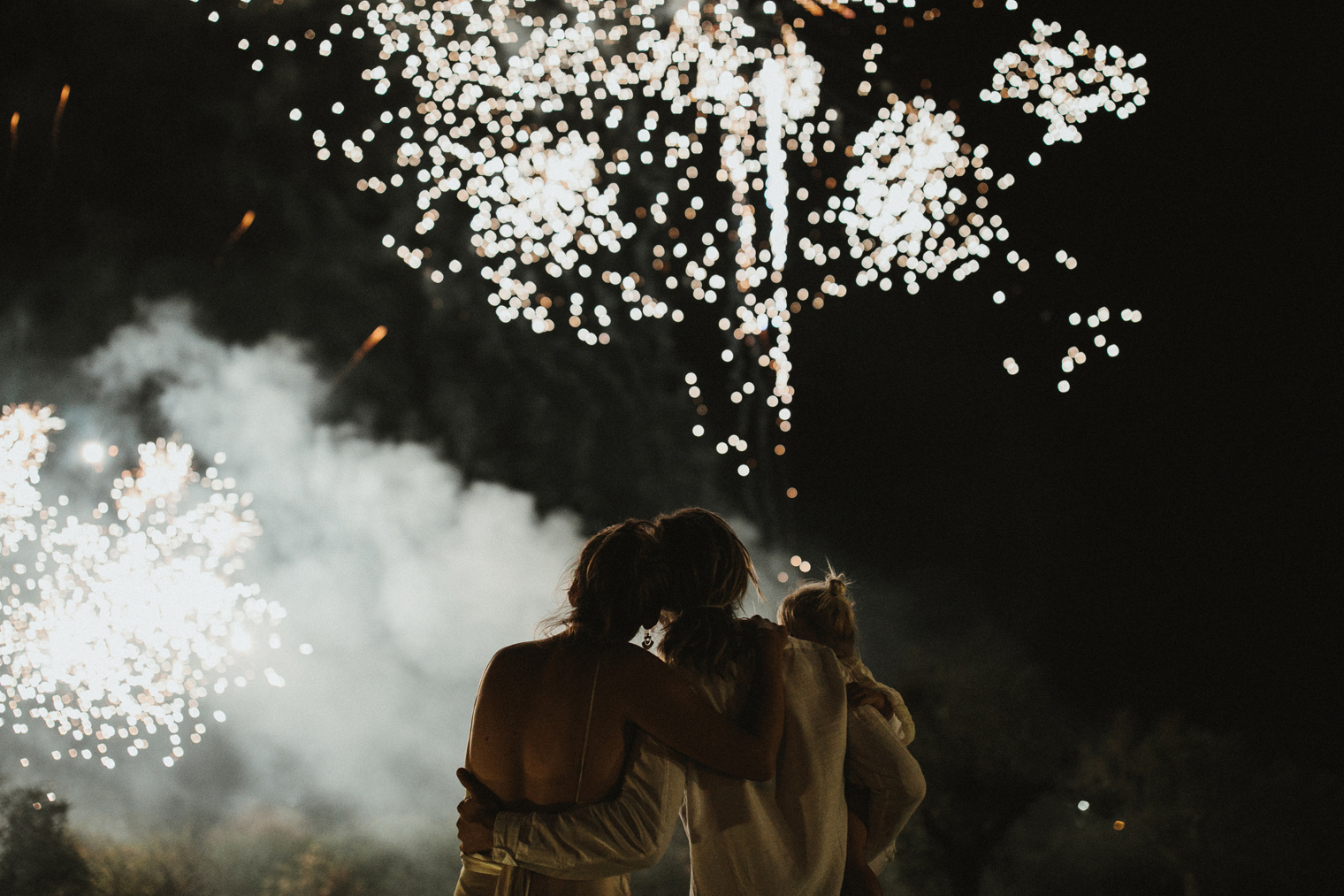 Couple watching fireworks after wedding celebration in Gallipoli