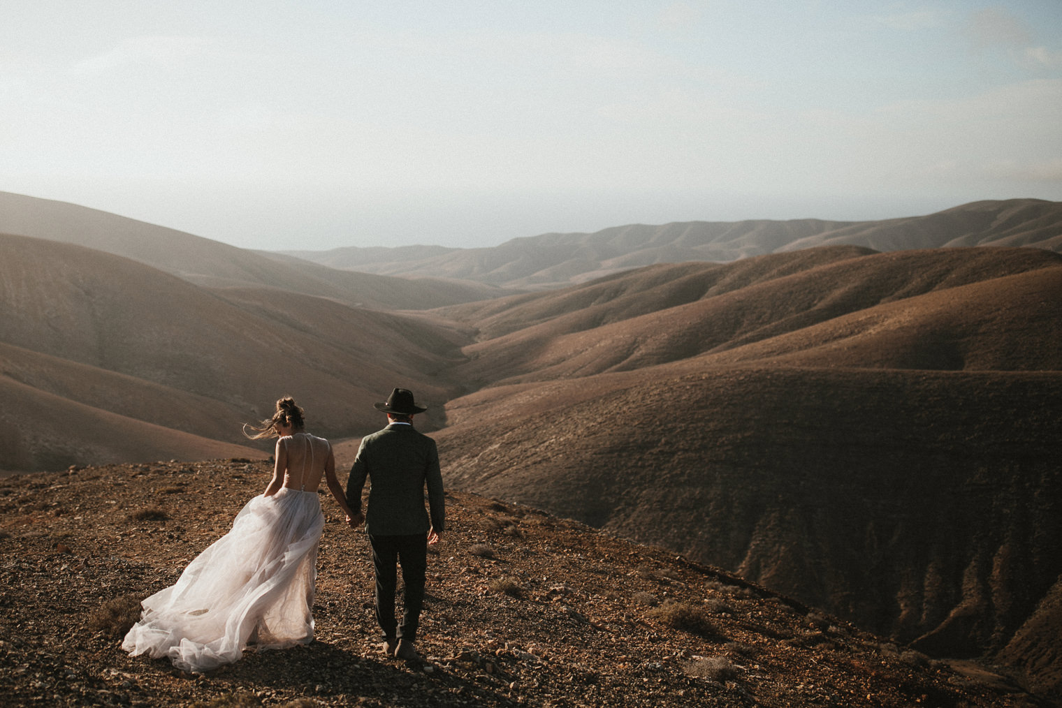 Bride and Groom walking in the mountains in Fuerteventura during a styled Fuerteventura Elopement shoot