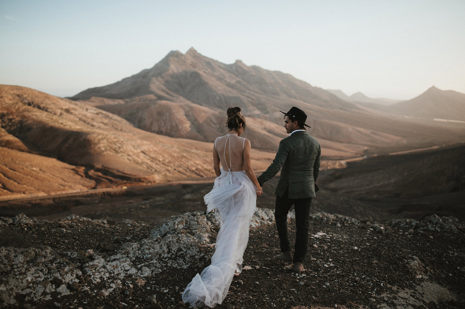 couple walking together in Fuerteventura at sunset
