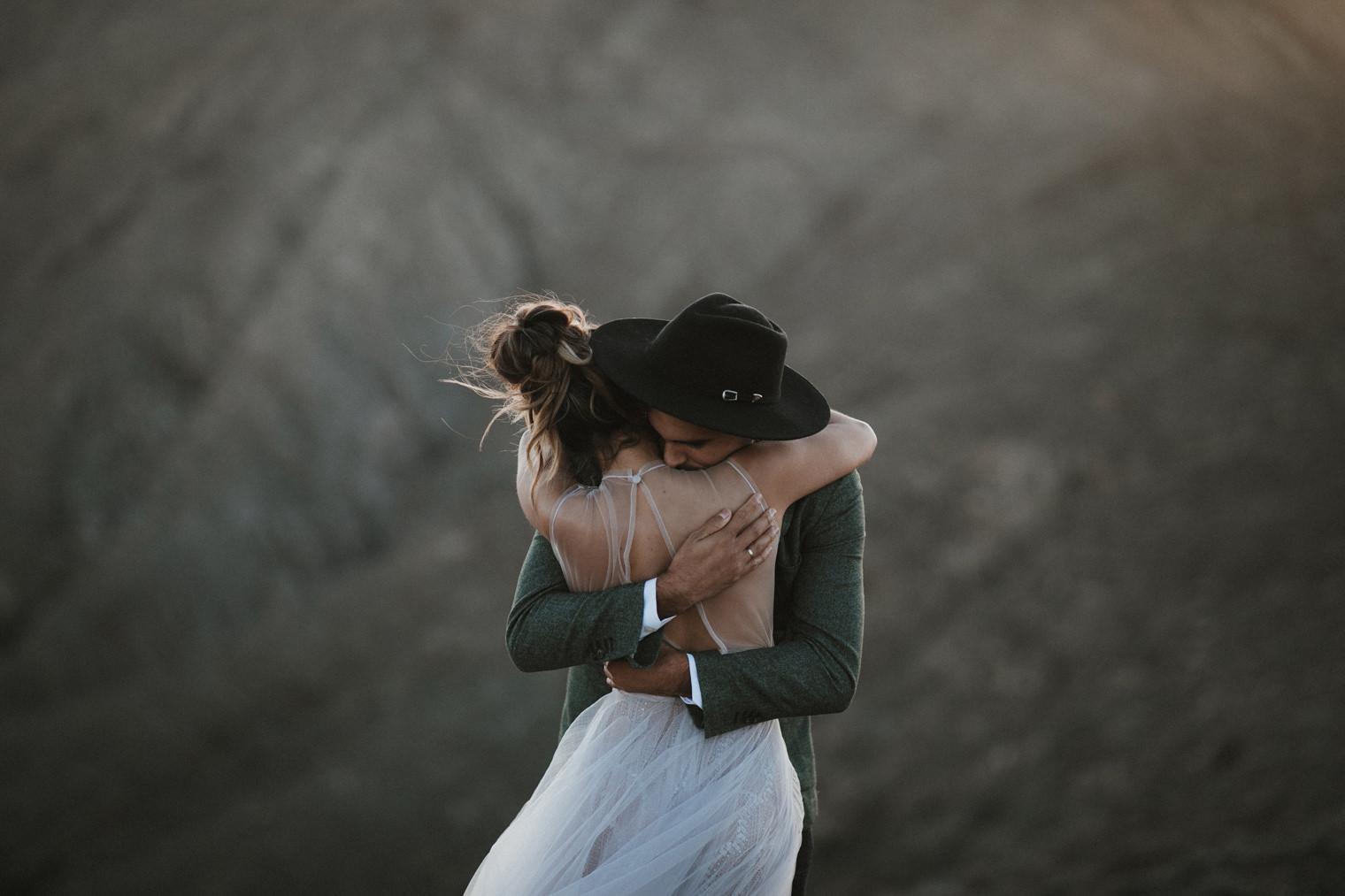 Groom tightly hugs bride during Fuerteventura elopement shoot