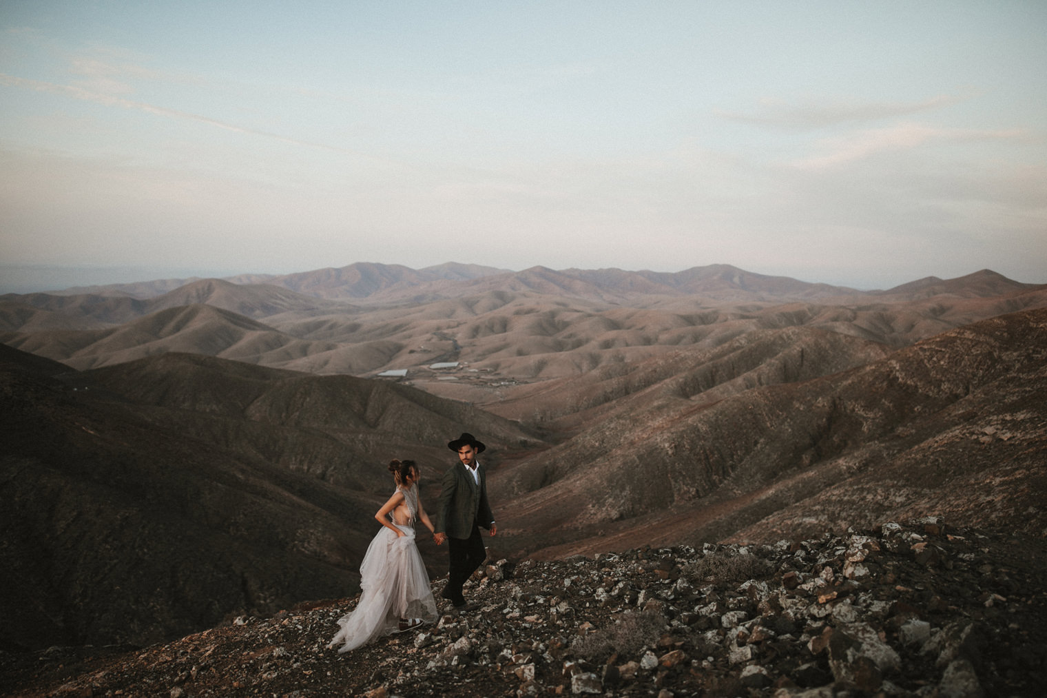 Bride and Groom walking together in the mountains of Fuerteventura