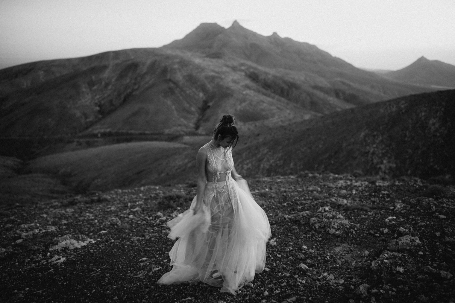 black and white photo of bride swaying her Marco & Maria Wedding gown