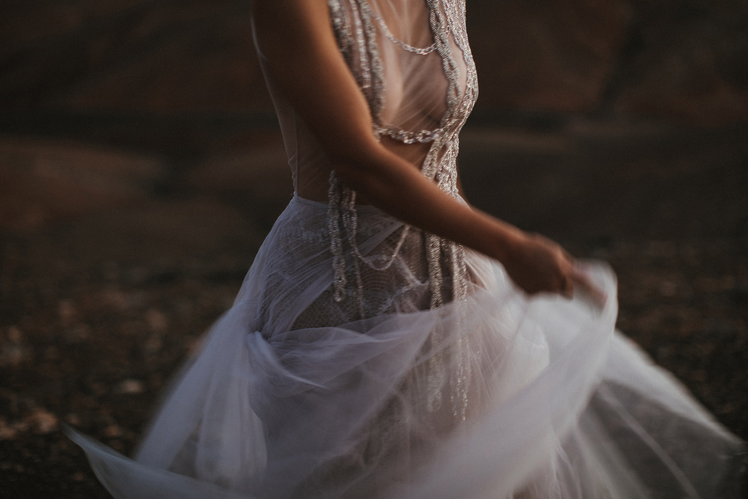 Bride swaying her Marco & Maria Wedding Gown